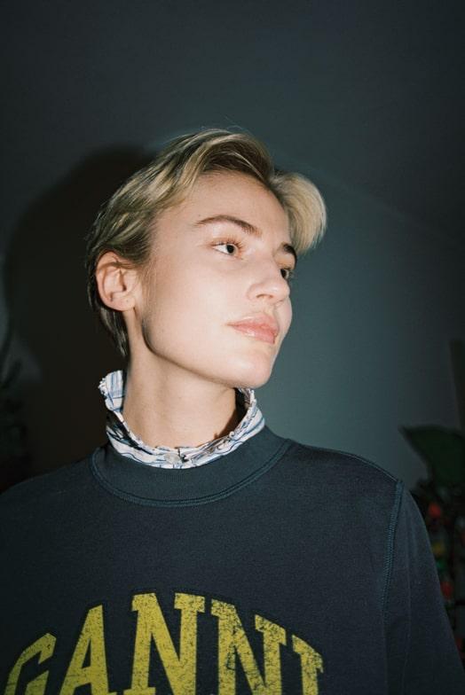 girl wearing ganni sweater